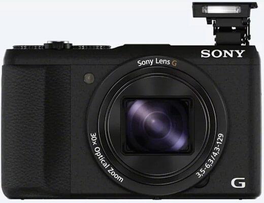 Sony-dsc-hx60 vista de frente con el flash desplegado