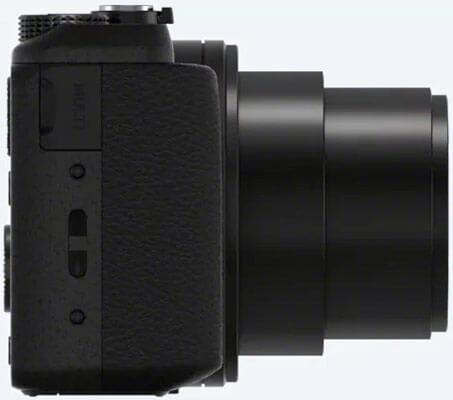 Sony dsc-hx60 vista desde el perfil derecho con el objetivo abierto